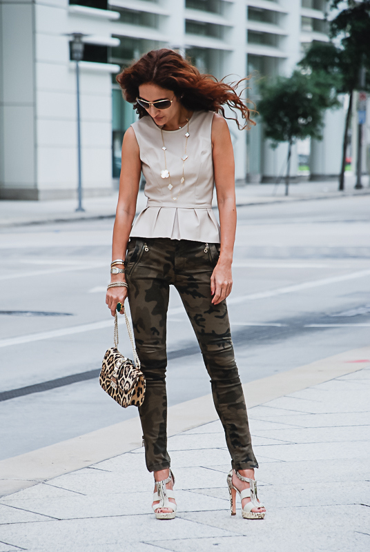 zara camouflage pants; leather peplum top; valentino rocksrud bag; python heels; van cleef magic alhambra necklace, bounkit ring