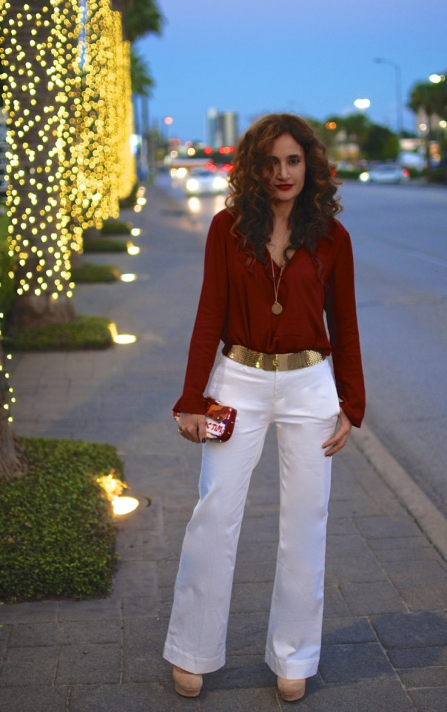 white flares how to wear flares for fall red tunic date night outfit dior clutch ysl suede palais heels taylor and tessier chic fall trends