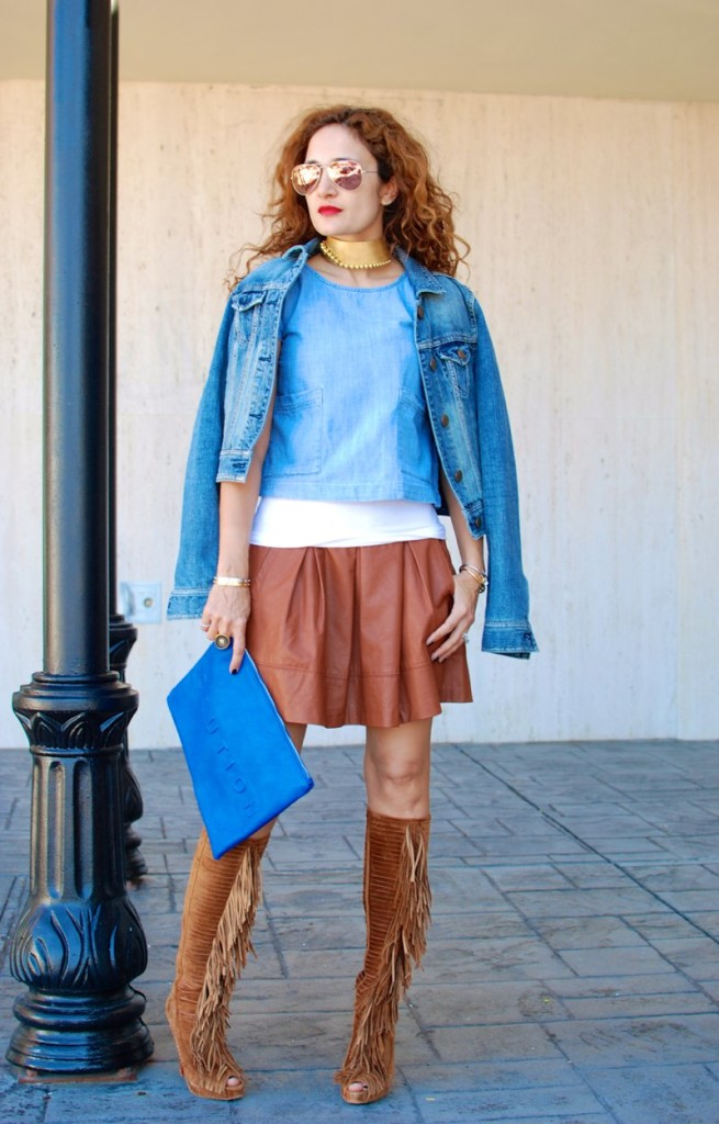 fall trends christian louboutin fringe boots sexy shoes denim jacket styled faux leather skater skirt blue and brown outfit houston fashion blogger