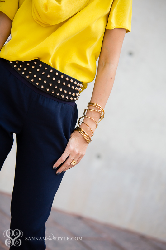 arm party bangles mustard and blue combo jogger pants casual with heels petite blogger curly hair