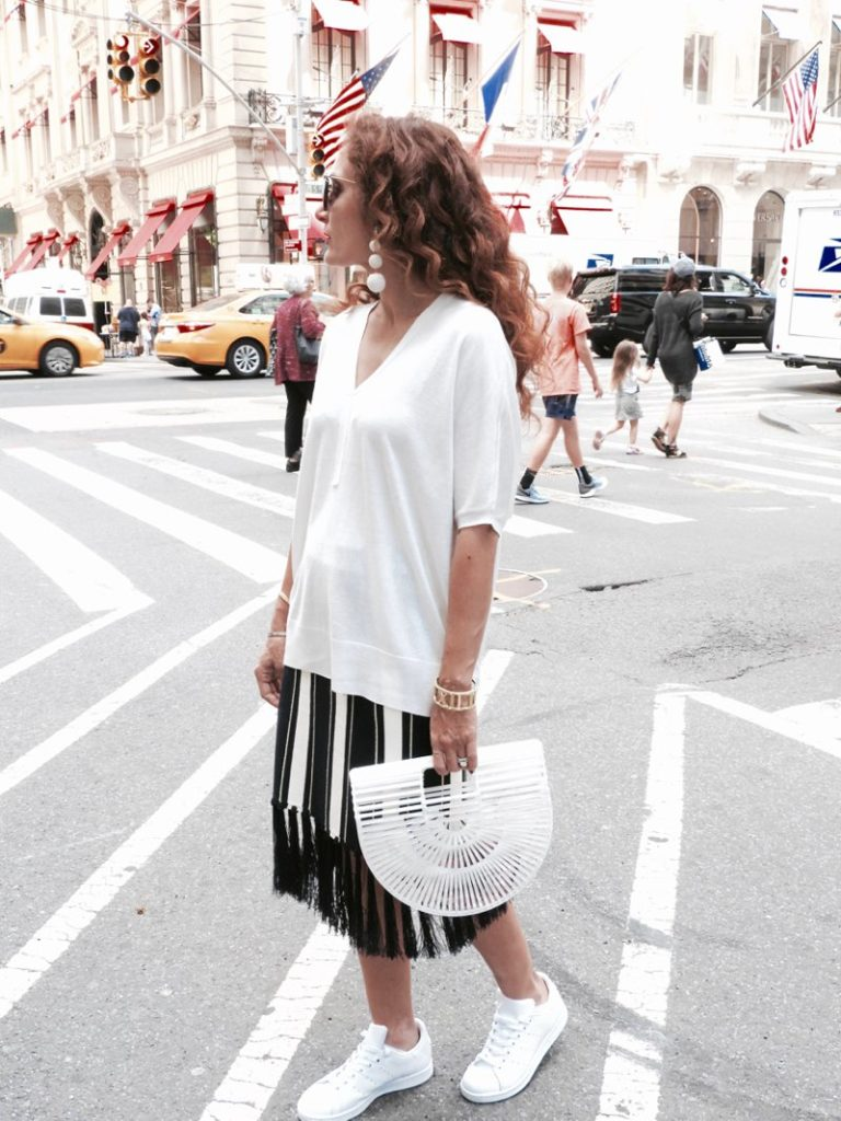 petite blogger adidas kicks fringe knit stripe skirt cult gaia ark bag mother of pearl rebecca de revanel ball earrings